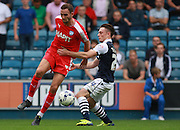 Chesterfield player Dan Gardner and Millwall player Ben Thompson tussle for possession during the Sky Bet League 1 match between Millwall and Chesterfield at The Den, London, England on 29 August 2015. Photo by Bennett Dean.