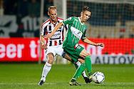 03-10-2015 VOETBAL: WILLEM II-PEC ZWOLLE:TILBURG<br /> Ryan Thomas van PEC Zwolle in duel met Frank van der Struijk van Willem II <br /> <br /> Foto: Geert van Erven