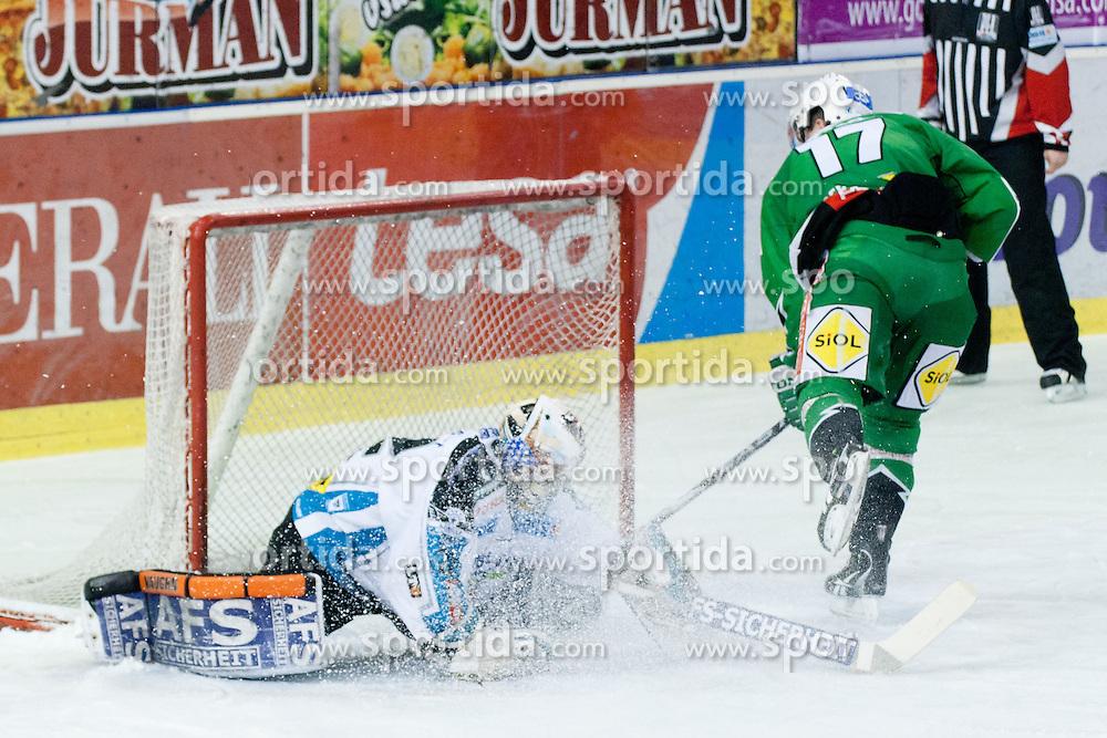 Justin Taylor (HDD Tilia Olimpija, #17) vs Alex Westlund (EHC Liwest Linz, #32) during ice-hockey match between HDD Tilia Olimpija and EHC LIWEST Linz in 35th Round of EBEL league, on December 30, 2011 at Hala Tivoli, Ljubljana, Slovenia. (Photo By Matic Klansek Velej / Sportida)