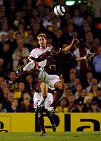 Photo: Henry Browne.<br /> Arsenal v FC Thun. UEFA Champions League.<br /> 14/09/2005.<br /> Gilberto of Arsenal challenges Sylvan Aegerter of Thun.