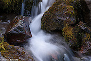 Water splashes and twists as it maneuvers rocks in Killen Creek.