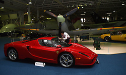 A Bonham employee prepares for Monday April 29, 2013 car auction at the RAF Museum in Hendon, London, UK. The most expensive car in the auction is this 2004 Ferrari Enzo. The car is expected to fetch £800,000 to 900,000 in the auction, photo taken Sunday April 28, 2013. Photo by: Max Nash / i-Images