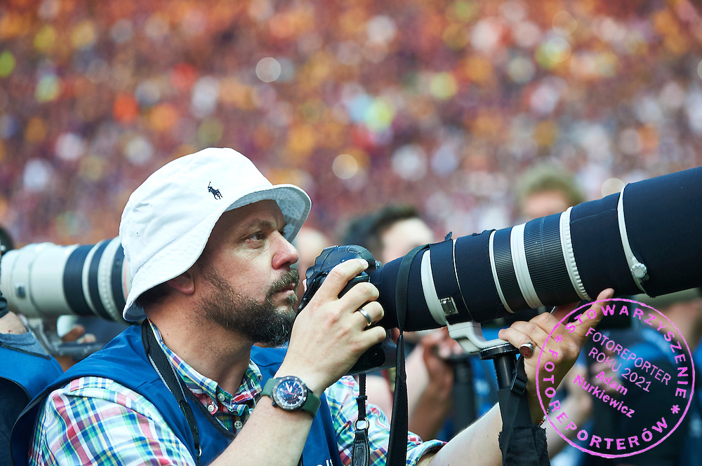 Photographer Kai Pfaffenbach with Canon camera works during the 2014/15 UEFA Champions League Final between Juventus and FC Barcelona at Olympiastadion on June 6, 2015 in Berlin, Germany.<br /> Germany, Berlin, June 6, 2015<br /> <br /> Picture also available in RAW (NEF) or TIFF format on special request.<br /> <br /> For editorial use only. Any commercial or promotional use requires permission.<br /> <br /> Adam Nurkiewicz declares that he has no rights to the image of people at the photographs of his authorship.<br /> <br /> Mandatory credit:<br /> Photo by &copy; Adam Nurkiewicz / Mediasport