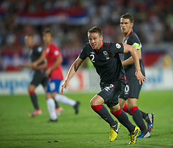 NOVI SAD, SERBIA - Tuesday, September 11, 2012: Wales' Chris Gunter in action against Serbia during the 2014 FIFA World Cup Brazil Qualifying Group A match at the Karadorde Stadium. (Pic by David Rawcliffe/Propaganda)