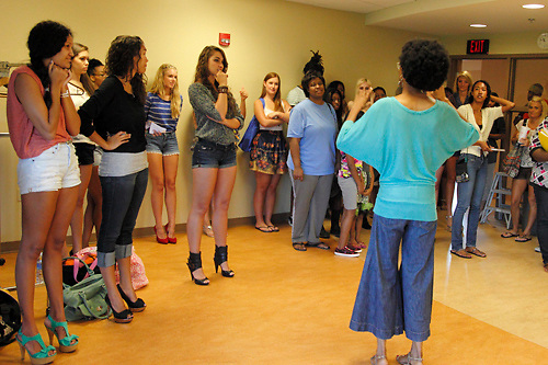 Karissa Brown (facing away from camera) gives information to prospective models during a Dayton Fashion Week meeting at SunWatch Indian Village/Archaeological Park in Dayton, Saturday, July 21, 2012.  Designers were both selecting models and doing fittings of their clothes at the meeting, in preparation for Dayton Fashion Week, which begins with Fashion For A Cause on July 21st, and concludes with the Finale Runway Showcase at the Dayton Convention Center on July 28th.