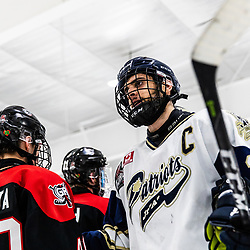 TORONTO, ON - APR 10, 2018: Ontario Junior Hockey League, South West Conference Championship Series. Game seven of the best of seven series between the Georgetown Raiders and the Toronto Patriots, Andrew Petrucci #21 of the Toronto Patriots shakes hands after the final whistle.<br /> (Photo by Kevin Raposo / OJHL Images)
