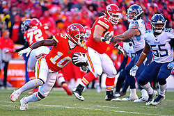 Jan 19, 2020; Kansas City, Missouri, USA; Kansas City Chiefs wide receiver Tyreek Hill (10) runs the ball against Tennessee Titans inside linebacker Jayon Brown (55) during the first half in the AFC Championship Game at Arrowhead Stadium. Mandatory Credit: Denny Medley-USA TODAY Sports