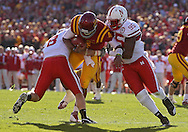 November 06 2010: Iowa State Cyclones quarterback Austen Arnaud (4) is hit by Nebraska Cornhuskers safety Austin Cassidy (8) and Nebraska Cornhuskers defensive end Pierre Allen (95) during the first half of the NCAA football game between the Nebraska Cornhuskers and the Iowa State Cyclones at Jack Trice Stadium in Ames, Iowa on Saturday November 6, 2010. Nebraska defeated Iowa State 31-30.