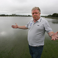 Brendan Wall in front of the waterlogged Ballycasey Soccer Pitches on Thursday.<br /> <br /> Photograph by Eamon Ward