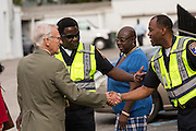 Charleston Mayor Joe Riley greets police officers standing outside the Fieldings Funeral home where the viewing for Walter Scott was held April 10, 2015 in Charleston, South Carolina. The mayor expressed his sorry for the Scott family after he was shot multiple times in the back by police in the neighboring city of North Charleston.