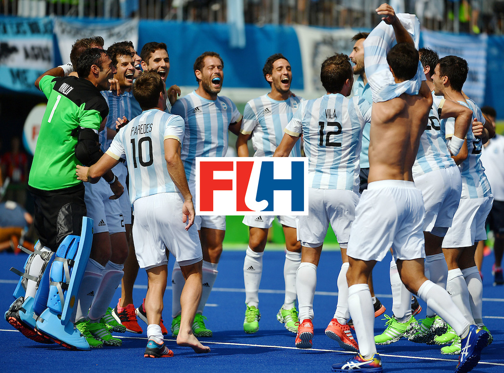 Argentina's players celebrate winning the men's semifinal field hockey Argentina vs Germany match of the Rio 2016 Olympics Games at the Olympic Hockey Centre in Rio de Janeiro on August 16, 2016. / AFP / Pascal GUYOT        (Photo credit should read PASCAL GUYOT/AFP/Getty Images)