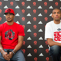 12 July 2013: Chicago Bulls superstar Derrick Rose answers journalists next to Portland Trail Blazers Nicolas Batum during Adidas' D Rose tour,  in Paris, France.