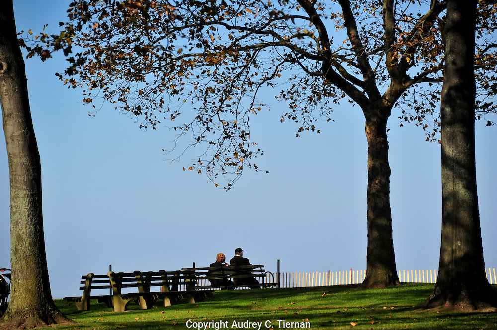 Port Washington, NY:   Tuesday,  November 8, 2011---   On a day that felt more like summer than fall, this couple found a friendly beach and took in the water views at North Hempstead Beach Park. © Audrey C. Tiernan