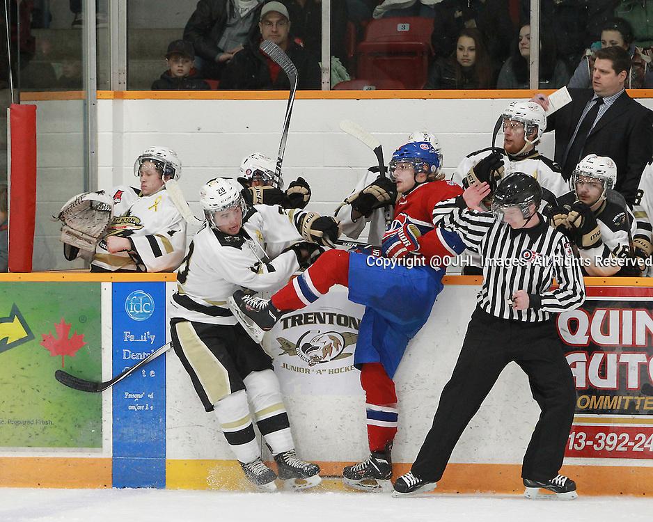TRENTON, ON - Mar 27, 2015 : Ontario Junior Hockey League game action between the Trenton Golden Hawks and the Kingston Voyageurs. Game one of the North East Championship Series. Reid Russell #28 of the Kingston Voyageurs makes the hit on the Kingston Voyageur player in the first period.<br /> (Photo by Tim Bates / OJHL Images)