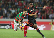 Maritimo´s player Xavier (L ) fights for the ball with Benfica's player Nélson Semedo   (R ) during Portuguese First League football match C.S. Maritimo vs S.L. Benfica held at Barreiros Stadium, Funchal, Portugal, 01 December, 2016.