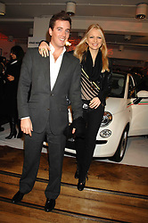 HANNAH SANDLING and OLIVER FELSTEAD at a party to celebrate the launch of the new Fiat 500 car held at the London Eye, Westminster Bridge Road, London on 21st January 2008.<br />