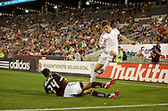 July 24th, 2012:  Swansea City AFC midfielder Ben Davies (33) takes a shot over the diving Colorado Rapids defender Tyrone Marshall (34) in the Rapids 2-1 win over Swansea City AFC in a international friendly soccer match in Denver, CO.