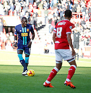 Elliott Bennett of Bristol City and Mohamed Diame of Hull City during the Sky Bet Championship match at Ashton Gate, Bristol<br /> Picture by Mike Griffiths/Focus Images Ltd +44 7766 223933<br /> 21/11/2015