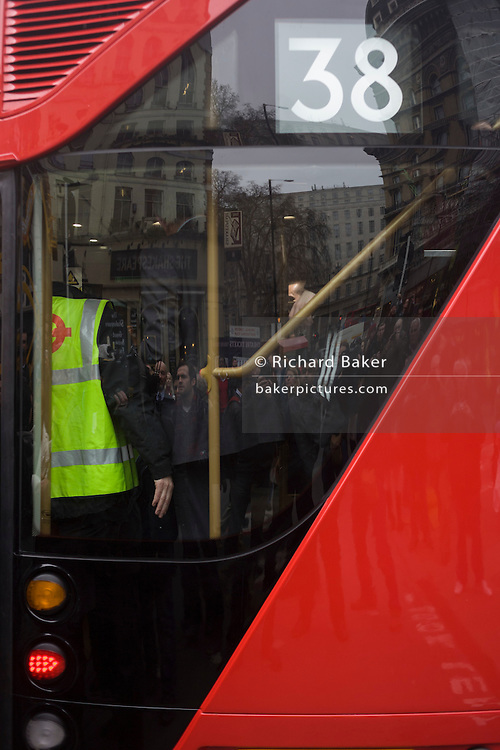 The open staircase of London's newest red double-decker Routemaster (27th Feb 2012) bus which is seen in service on the capital's streets for the first time. The hybrid NB4L, or the Borismaster, New Routemaster or Boris Bus, is a 21st century replacement of the iconic Routemaster as a bus built specifically for use in London and is said to be 40 per cent more fuel efficient than conventional diesel buses. The brainchild of London's Conservative mayor Boris Johnson, its funding has been controversial amid massive fare increases in transport.