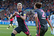 Leeds United defender Ezgjan Alioski (10) scores a goal and celebrates to make the score 0-1 during the EFL Sky Bet Championship match between Huddersfield Town and Leeds United at the John Smiths Stadium, Huddersfield, England on 7 December 2019.
