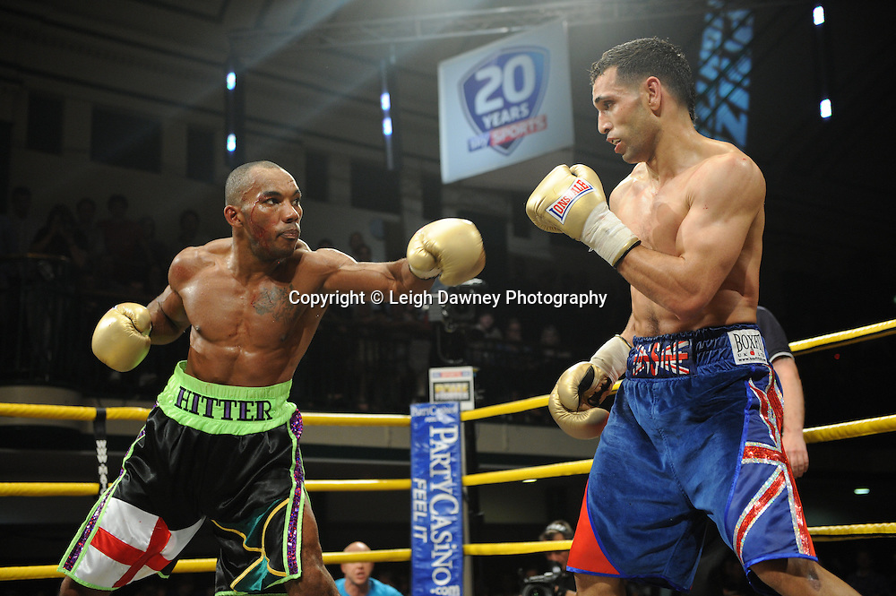 Yassine El Maachi (red/blue shorts) defeats Junior Witter in the final to claim the title of Prizefighter Welterweights II,York Hall, Bethnal Green ,London. 07.06.11. Matchroom Sport/Prizefighter.Photo credit: Leigh Dawney 2011