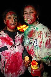 Young girl and boys enjoying the Hindu Holi festival; celebration of colours,