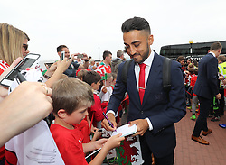 CARDIFF, WALES - Saturday, June 4, 2016: Wales' Neil Taylor and his team sign autographs for Ysgoal Treganna students as the team are given a colourful send off at Cardiff Airport as the squad head to Sweden for their last friendly before the UEFA Euro 2016 in France. (Pic by David Rawcliffe/Propaganda)
