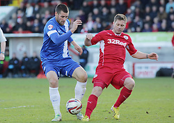 Peterborough United's Michael Bostwick in action with Crawley Town's Dannie Bulman - Photo mandatory by-line: Joe Dent/JMP - Tel: Mobile: 07966 386802 01/03/2014 - SPORT - FOOTBALL - Crawley - Broadfield Stadium - Crawley Town v Peterborough United - Sky Bet League One
