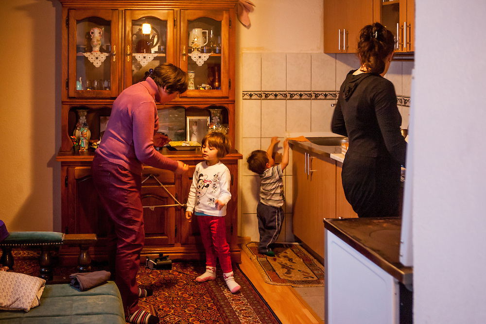 The family of former refugee Elvis Causevic with his wife Irma (right) and his mother Dzevada (left) talking to their daughter Adna (left, 3 1/2) and son Aldin (1 1/2) in the kitchen at the  families house in Hadžići. The family settled here after the war ended in Bosnia. Hadžići is a town and a municipality located about 20 km south west of Sarajevo city but within the Sarajevo Canton of Bosnia and Herzegovina. According to the census of 2013, Hadžići municipality has a population of 23,891 residents.