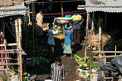 BANGLADESH DHAKA KAWRAN BAZAAR 27FEB05 - Porters at work in the Kawran Bazaar vegetable market. The Bazaar has been in the Tejgaon area for at least 30 years and is one of the largest markets in Dhaka city...jre/Photo by Jiri Rezac ..© Jiri Rezac 2005..Contact: +44 (0) 7050 110 417.Mobile:  +44 (0) 7801 337 683.Office:  +44 (0) 20 8968 9635..Email:   jiri@jirirezac.com.Web:    www.jirirezac.com..© All images Jiri Rezac 2005- All rights reserved.