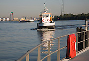 The Waterbus is a public transportation system on the River Maas linking Rotterdam to Dordrecht and with several smaller branch lines, South Holland, Netherlands. This is the small waterbus between Ridderkerk and Kinderdijk.