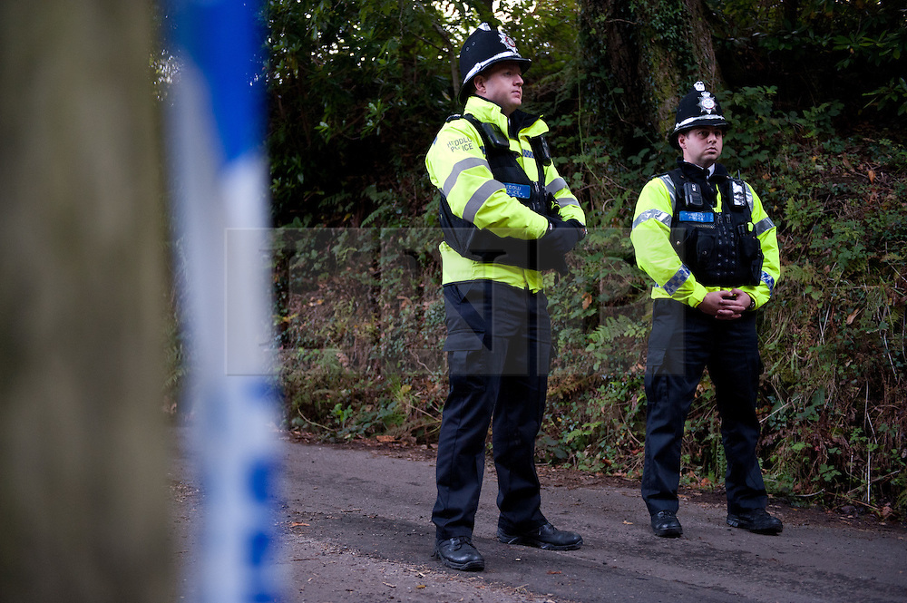 © licensed to London News Pictures  16/09/2011 .  Pontardawe,UK. ..Picture: Police Stand at the road to the mine..News of a miner found dead at the mine is broken  as an operation continues to rescue  miners trapped in a mine in the Swansea Valley. Photo credit :Aled Llywelyn/LNP