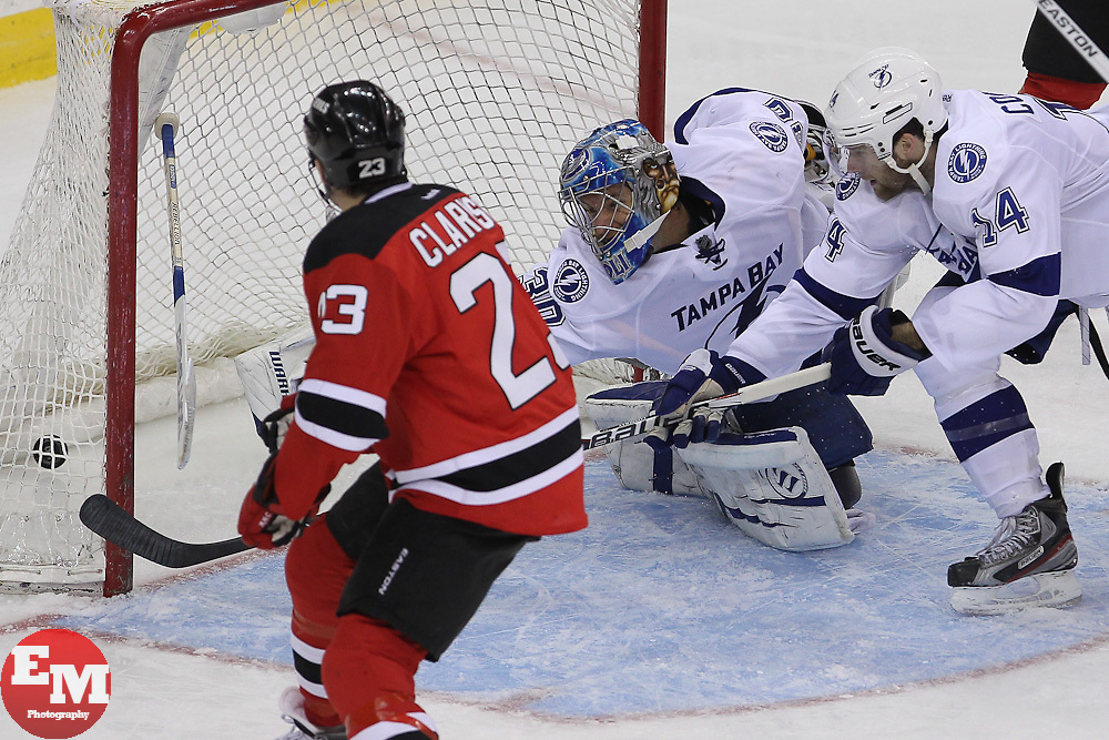 Mar 29; Newark, NJ, USA; New Jersey Devils right wing David Clarkson (23) scores a goal on Tampa Bay Lightning goalie Dwayne Roloson (30) during the third period at the Prudential Center. The Devils defeated the Lightning 6-4.