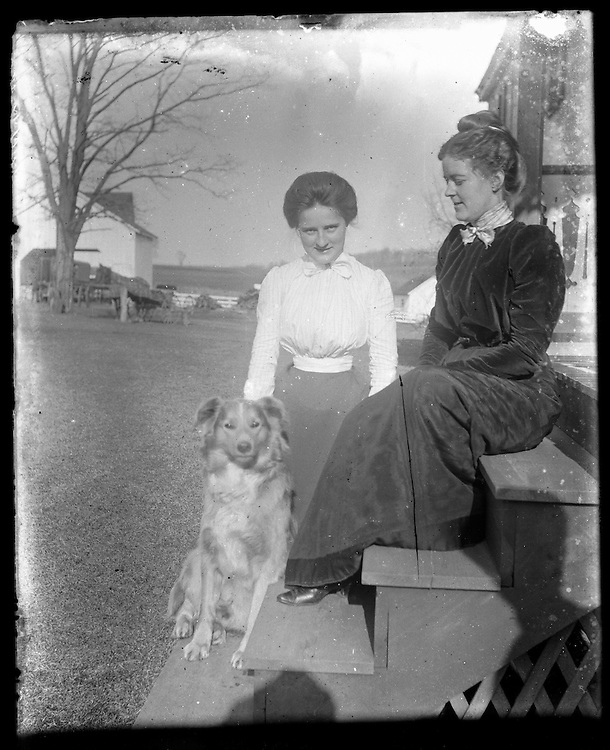 Victorian photograph of two women and a dog on their front steps in Fallston, Maryland.