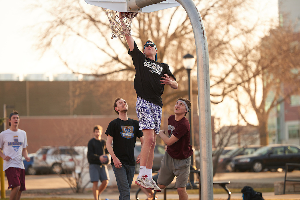 Activity; Playing; Relaxing; Socializing; Location; Outside; People; Student Students; UWL UW-L UW-La Crosse University of Wisconsin-La Crosse; Spring; March; Time/Weather; evening; Type of Photography; Candid; Basketball; Campus Life