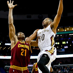 Nov 22, 2013; New Orleans, LA, USA; New Orleans Pelicans shooting guard Eric Gordon (10) shoots over Cleveland Cavaliers center Andrew Bynum (21) during the second quarter of a game at New Orleans Arena. Mandatory Credit: Derick E. Hingle-USA TODAY Sports