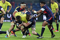 Matthew Trouville  (CR) of USA tries to stop Daniel Carpu (CL) of Romania during their  rugby test match, on National Stadium Arc de Triomphe in Bucharest, November 8, 2014.