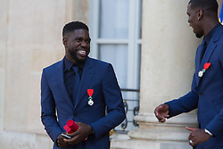France's national Samuel Umtiti leaves after receiving the Legion of Honour during a ceremony to award French 2018 football World Cup winners, on June 4, 2019, at the Elysee Palace in Paris. Photo by Raphael Lafargue/ABACAPRESS.COM