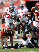 TAMPA, FL - OCTOBER 15:  Tight end Alex Smith #81 of the Tampa Bay Buccaneers tries to break a tackle as he gains some yardage after a catch against the Cincinnati Bengals at Raymond James Stadium on October 15, 2006 in Tampa, Florida. The Bucs defeated the Bengals 14-13. (©Paul Anthony Spinelli) *** Local Caption *** Alex Smith