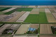 Nederland, Groningen, Gemeente Eemsmond, 08-09-2009;  Uithuizer polderdijk, dan de Eemspolder. De percelen grenzend aan de Waddenzee liggen in de Emmapolder. <br /> Polder dike with the Ems Polder. The parcels adjacent to the Wadden Sea lay in the Emma Polder. <br /> luchtfoto (toeslag); aerial photo (additional fee required); <br /> foto Siebe Swart / photo Siebe Swart