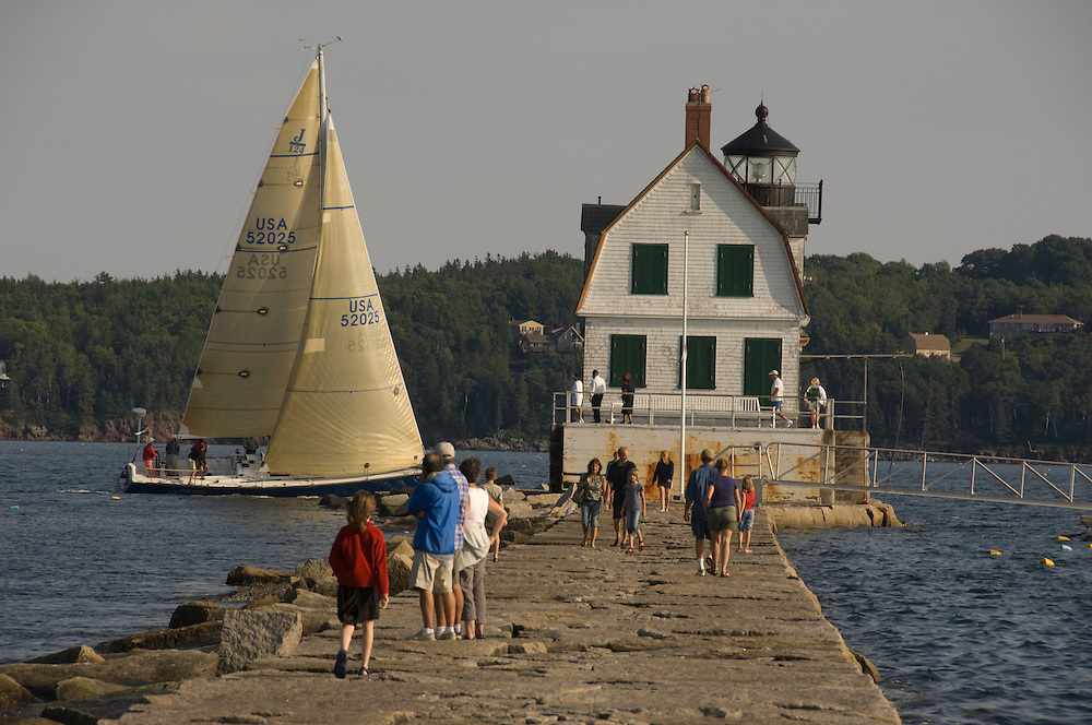 Lighthouse and sailboat, Rockland Maine USA
