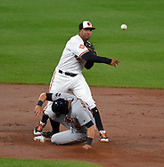 August 3, 2017 - Baltimore, MD, USA - Baltimore Orioles second baseman Jonathan Schoop turns a triple play to end the second inning, getting the force out on the Detroit Tigers' Mikie Mahtook, at Oriole Park at Camden Yards in Baltimore on Thursday, Aug. 3, 2017. (Credit Image: © Lloyd Fox/TNS via ZUMA Wire)
