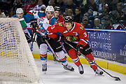 KELOWNA, CANADA - APRIL 07:  Erik Gardiner #12 of the Kelowna Rockets, Caleb Jones #3 of the Portland Winterhawks at the Kelowna Rockets game on April 07, 2017 at Prospera Place in Kelowna, British Columbia, Canada.  (Photo By Cindy Rogers/Nyasa Photography,  *** Local Caption ***