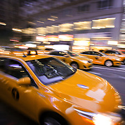 Taxi cabs race down 5th Ave. in New York City. Part of a story that explored southerners visiting Manhattan for the first time. ©Travis Bell Photography
