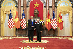 February 27, 2019 - Hanoi, Vietnam - U.S President DONALD TRUMP and Vietnamese President NGUYEN PHU TRONG greet prior to their meeting in the Mirror Room of the Presidential Palace in Hanoi, Vietnam. (Credit Image: © Shealah Craighead/The White House via ZUMA Wire)