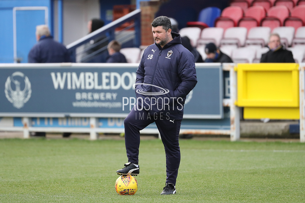 AFC Wimbledon first team coach Simon Bassey  watching warm up during the EFL Sky Bet League 1 match between AFC Wimbledon and Wigan Athletic at the Cherry Red Records Stadium, Kingston, England on 16 December 2017. Photo by Matthew Redman.