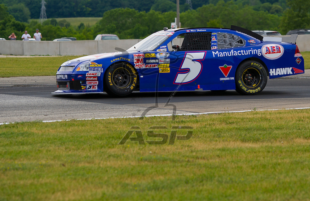 Elkhart Lake,WI - JUN 23, 2012: Ron Fellows (5) drives during the Sargento 200 at Road of America in Elkhart Lake , WI.