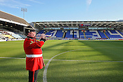 A bugler practising the last post at the Abax Stadium before the EFL Sky Bet League 1 match between Peterborough United and Bolton Wanderers at London Road, Peterborough, England on 13 November 2016. Photo by Nigel Cole.