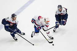Mats Rosseli Olsen of Norway between Richard Panik of Slovakia and Michel Miklik of Slovakia during Ice Hockey match between Slovakia and Norway at Day 6 in Group B of 2015 IIHF World Championship, on May 6, 2015 in CEZ Arena, Ostrava, Czech Republic. Photo by Vid Ponikvar / Sportida