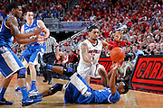 LOUISVILLE, KY - DECEMBER 29: Peyton Siva #3 of the Louisville Cardinals battles for the ball against Ryan Harrow #12 of the Kentucky Wildcats at the KFC Yum! Center in Louisville, Kentucky. Louisville won 80-77. (Photo by Joe Robbins)